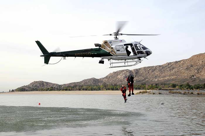 PS Divers deploy from helicopter