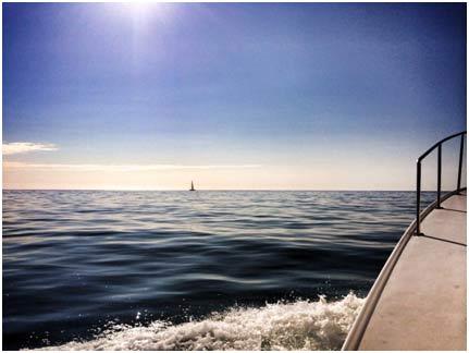 Dive boat on horizon