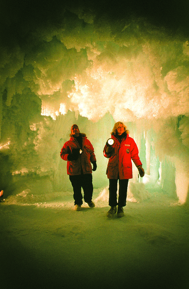 Giddings and Shawn Wetherly in ice cave filming Ocean Quest series, 1985