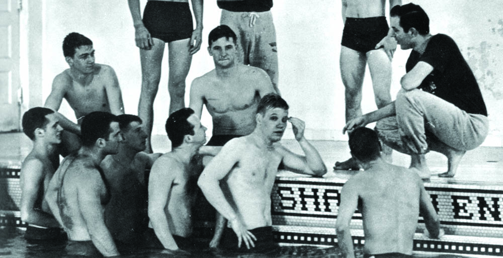 Washbur University swim team, coach Paul at right in dark tee shirt, 19662