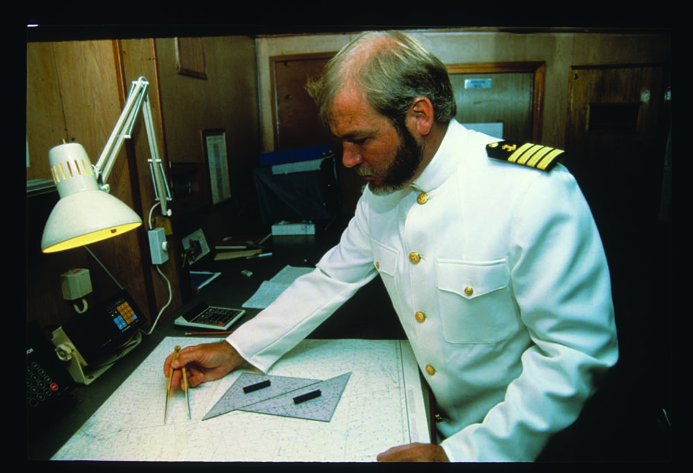 Capt. Gilliam at chart table