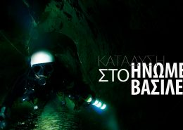 diver inside mine cave with white helmet and flashlight