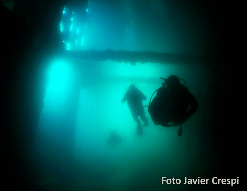3 divers scuba diving taken by Javier Crespi